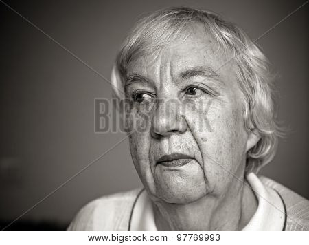 Senior woman pensive and worried. Black and white portrait