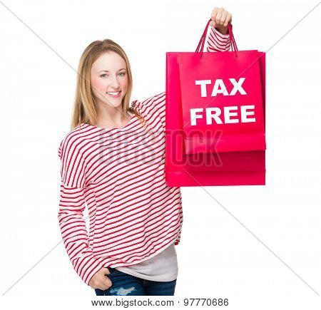 Woman hold with shopping bag and showing tax free