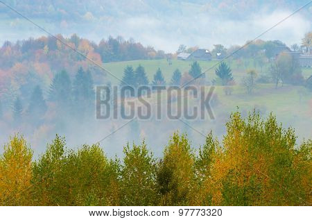 Autumn mist. Mountain village. Carpathians, Ukraine, Europe