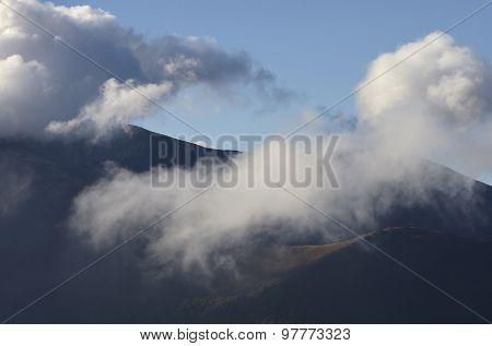 Mountain peaks in cumulus clouds. Carpathians, Ukraine, Europe
