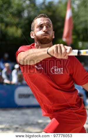 MOSCOW, RUSSIA - JULY 16, 2015: Gerard Rodriguez of Spain in the match of the Beach Tennis World Team Championship against San Marino. Spain won the match 3-0