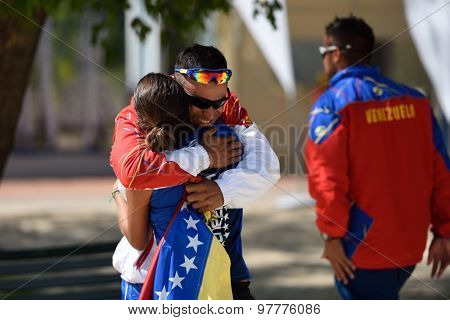 MOSCOW, RUSSIA - JULY 17, 2015: Ramon Guedez congratulates Lady Correa of Venezuela after the victory in a rubber of the match of Beach Tennis World Team Championship against Spain. Spain won 2-1