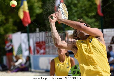 MOSCOW, RUSSIA - JULY 16, 2015: Vinicius Font (in front) and Samantha Barijan of Brazil in the match of the Beach Tennis World Team Championship against Hungary. Brazil won the match 3-0
