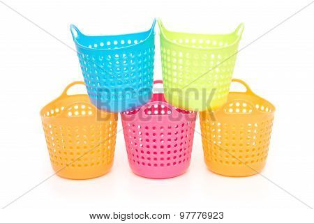 Small And Colorful Baskets Stack Up On A White Background
