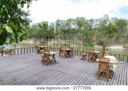 Wooden Table And Chair On Terrace At Waterside
