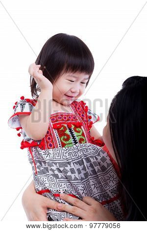 Asian Mother Playing Her Adorable Little Daughter, On White. Studio Shot