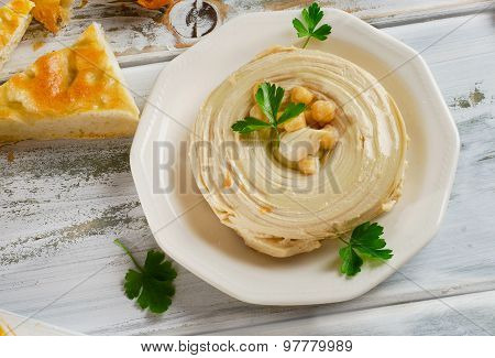 Plate Of  A Hummus With Pita And Parsley.