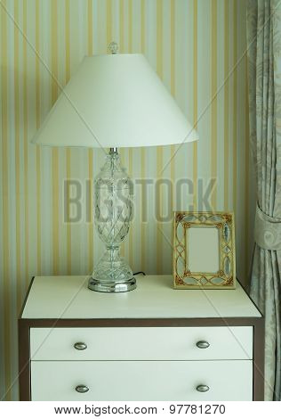 Bedside Table With Lamp, And Picture Frame