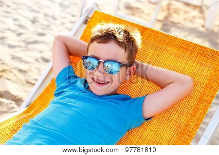 Little Boy In Relax On Deck Chair