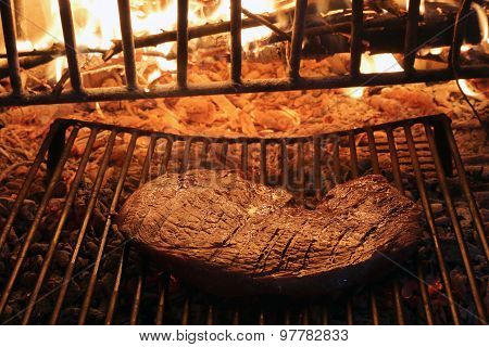 Huge Beef Steak Cooked On The Barbeque Fireplace
