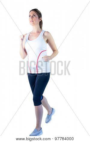 Pretty blonde woman running on white background