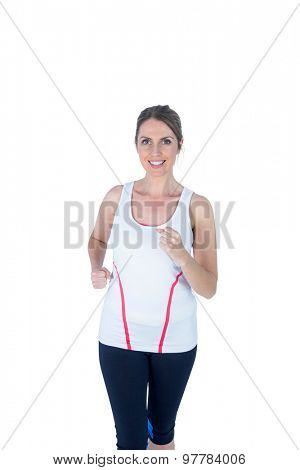 Portrait of a pretty blonde woman running on white background