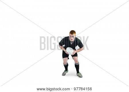 Rugby player running with a rugby ball on a white background