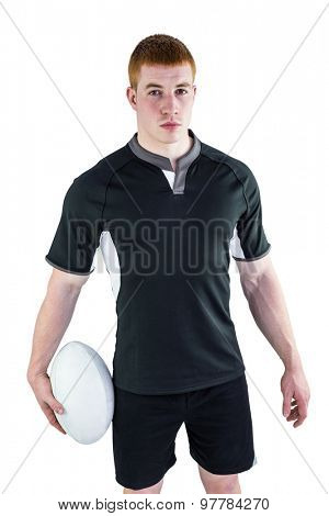 Portrait of a serious rugby player holding a rugby ball