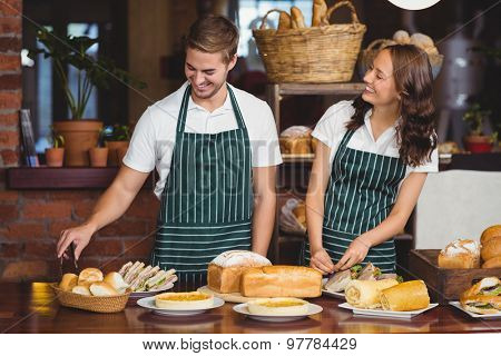 Smiling co-workers working together at the coffee shop