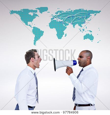Businessman yelling with a megaphone at his colleague against world map