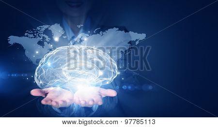 Businesswoman hold brain digital image on hand