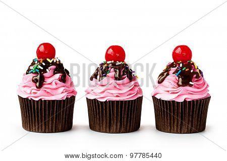 Row of ice cream sundae cupcakes on white