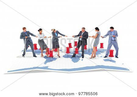 Business team pulling the rope against world map with pointers