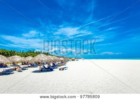 Thatched umbrellas on a beautiful summer day on the beach