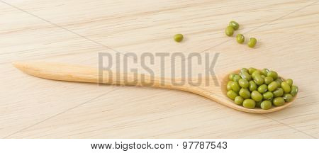 Mung Beans In Wooden Spoon On Cutting Board