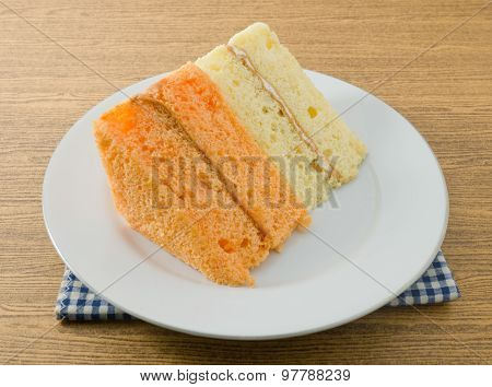 Vanilla And Orange Chiffon Cake On A Dish