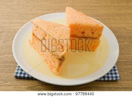 Two Orange Chiffon Cake On A Dish