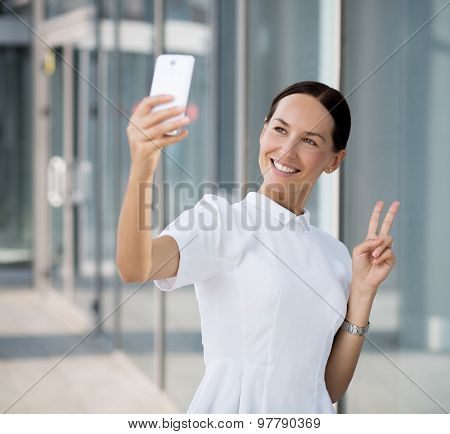 Businesswoman making selfies