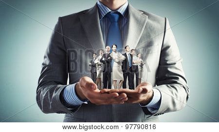 Close up of businessman holding in hands successful business team