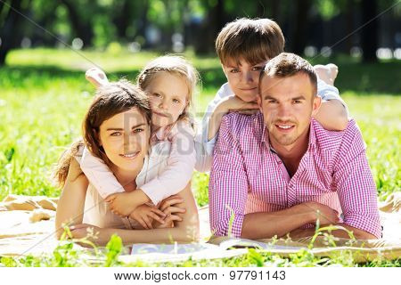 Happy family having weekend in summer park