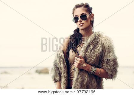 Fur coat and flash tattoos