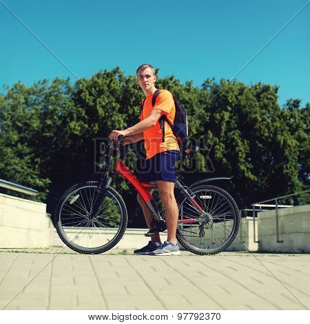 Sport, Leisure And Healthy Lifestyle Concept - Young Man On A Bicycle In Summer Day Over Blue Sky, M