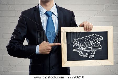 Close up of businessman holding chalkboard with business ideas