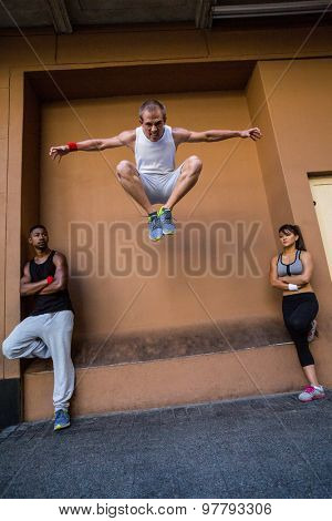Group of people doing parkour in the city on a sunny day