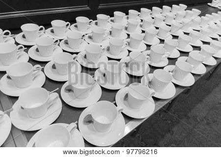 Many White Coffee Cups Are Provided Below Made With Black And White Color.