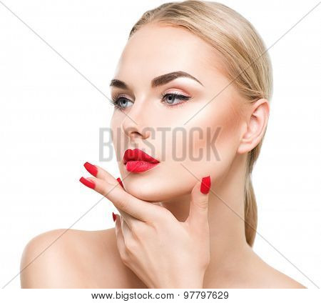 Beautiful fashion model Woman with blond hair. Red lipstick and nails. Portrait of glamour girl with bright makeup isolated on white background. Beauty female face close up with perfect make up