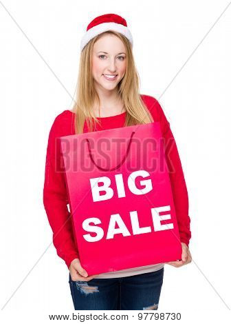 Woman with paper bag showing big sale