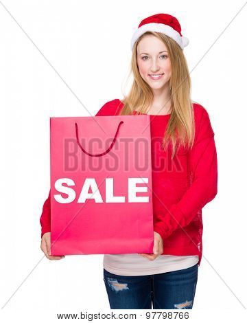 Christmas party Woman with red paper bag showing sale