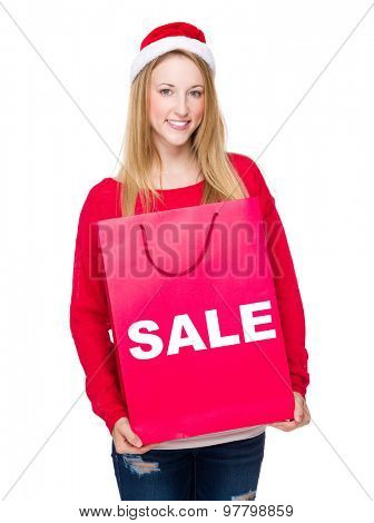 Woman with paper bag showing sale