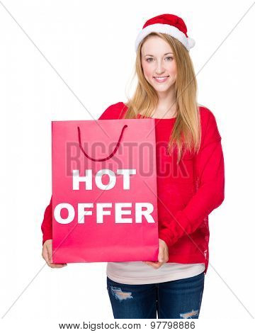 Christmas party Woman with red paper bag showing hot offer