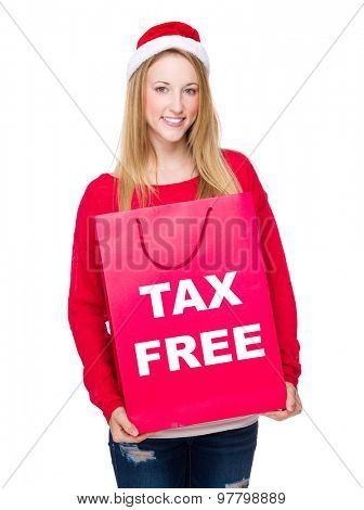 Woman with paper bag showing tax free