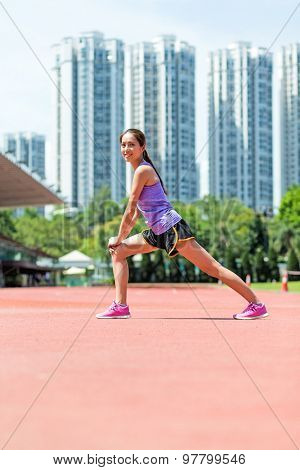 Woman do warm up exercise at sport arena
