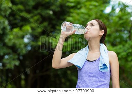 Sporty Woman drink water at outdoor