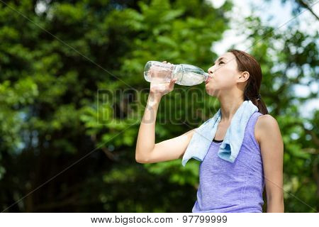 Young Sporty Woman drink water at outdoor