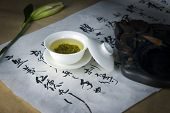 Green tea and Chinese calligraphy