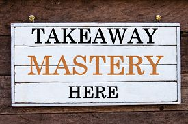 stock photo of takeaway  - Takeaway Mastery Here Inspirational message written on vintage wooden board - JPG