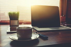 stock photo of coffee coffee plant  - Home freelance desktop with open laptop computer - JPG