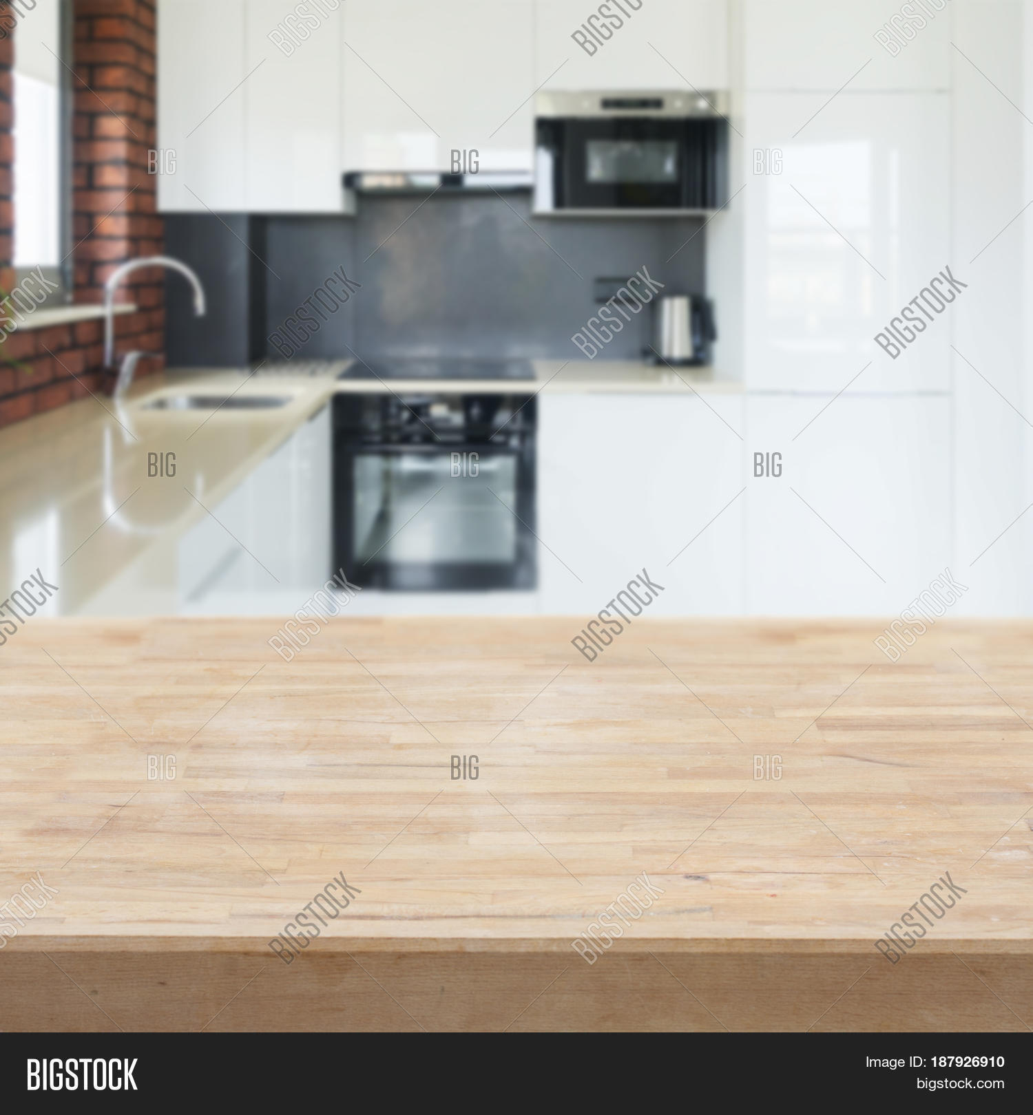 Kitchen Table Top Background empty kitchen table top with white modern kitchen in background