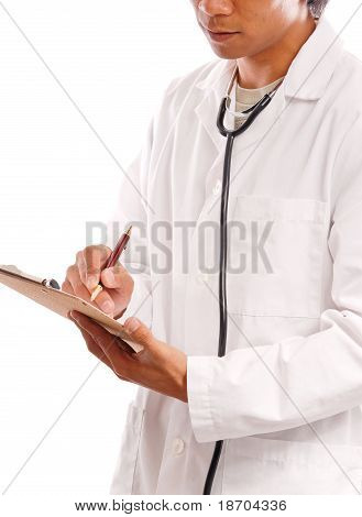 Doctor Filling Out Paper Work