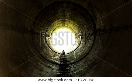 Underground Tunnel Leading Towards The Light